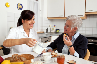 caregiver assisting elder in eating